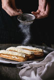 Eclairs in metal plate Stock Photo