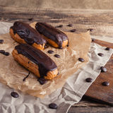 Eclairs or Profiterole with Dark Chocolate. Cooking on Baking Sh Stock Image