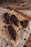 Eclairs or Profiterole with Dark Chocolate. Cooking on Baking Sh Stock Photo