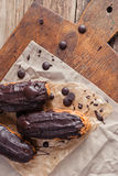 Eclairs or Profiterole with Dark Chocolate. Cooking on Baking Sh Royalty Free Stock Photography