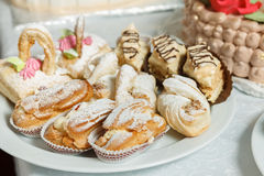 Eclairs sweets with cream sprinkled sugar powder. Baking sweets for dessert in the shop window Royalty Free Stock Image