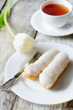 Eclairs on a white plate Royalty Free Stock Photos