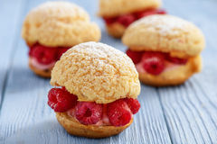 Free Eclairs With Mascarpone Cream And Raspberries. Royalty Free Stock Photography - 95261677