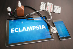 Eclampsia (heart disorder) diagnosis medical concept on tablet s. Creen with stethoscope royalty free stock images