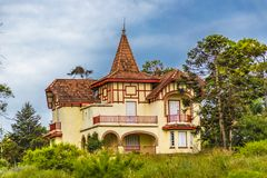 Eclectic Style Chalet Exterior Facade. Exterior view of eclectic old style chalet at field, Maldonado, Uruguay Stock Images