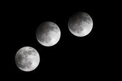 Eclipse lunar parcial observado no 21:53: 42 ao 23:00: 33, Barém 25 de abril de 2013 Imagem de Stock