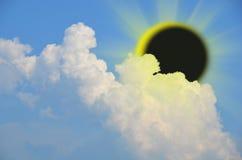 Eclipse solar con las nubes Imagen de archivo libre de regalías