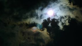 The eclipse of the sun in the sky. The eclipse through the cloud stock video footage