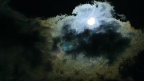 The eclipse of the sun in the sky. The eclipse through the cloud stock footage