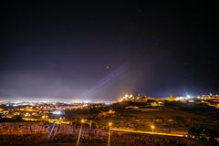 Moon and Mars. Eclipsed Moon and Mars over Mdina in Malta stock photography