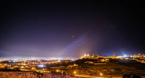 Moon and Mars. Eclipsed Moon and Mars over Mdina in Malta stock photo
