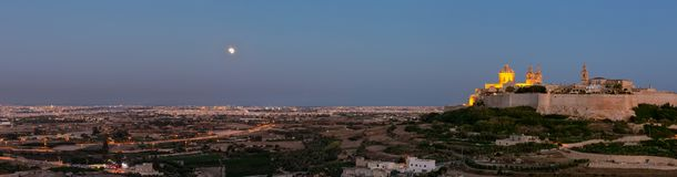 Moon and Mars. Eclipsed Moon and Mars rise over Malta stock photo