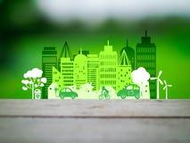 Eco在绿色背景的市概念 库存照片