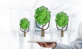 Eco绿化树提出的环境概念作为运作的机制或引擎 库存照片