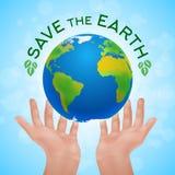 Eco affisch av två mänskliga händer som rymmer planetjord Fotografering för Bildbyråer