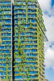 Green skyscraper with hydroponic plants on the facade, Sydney, Australia. Eco architecture. Green skyscraper building with plants growing on the facade. Ecology royalty free stock image