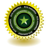 Eco assured gold icon. Golden web icon awards with eco text and star Stock Image
