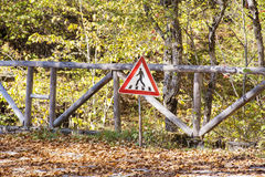 Eco autumn trail with Traffic sign for pedestrian crossing Royalty Free Stock Photo