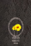 Eco background with soil and light bulb silhouette Stock Images