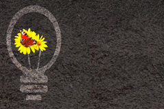 Eco background with soil and light bulb silhouette Stock Photography