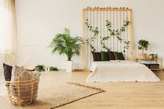 Eco bedroom with rope wall royalty free stock photos