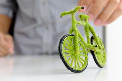 Eco bicycle icon concept. Hand Holding Eco bicycle icon concept Stock Photos