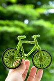 Eco bicycle icon,energy concept. Hand Holding Eco bicycle icon,energy concept Stock Photos