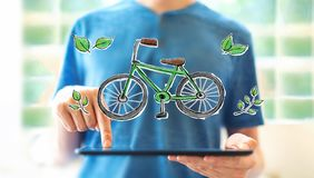 Eco bicycle with man using a tablet royalty free stock photo