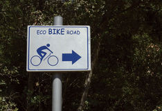 Eco bike road sign. Against trees Royalty Free Stock Images