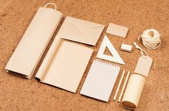 Eco blank packaging, stationery, gifts template of  kraft paper  on   brown coconut fiber background, tilt. Stock Photos