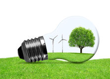 Eco bulb with wind turbines and tree Royalty Free Stock Image
