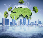 Eco business concept. Abstract globe with green trees on city background. Eco business concept Royalty Free Stock Photos