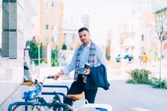 Eco businessman ready to paddle his way back home. On his bicycle royalty free stock photography