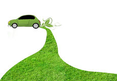 Eco car. On white background with grass track behind it Stock Photo