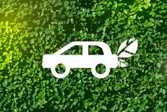 Eco-car on a green background - the concept of love the world stock photography