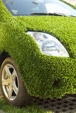 Eco car with green grass Royalty Free Stock Image