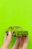 Eco car icon. Hand Holding Eco car icon isolate on green background Royalty Free Stock Photo