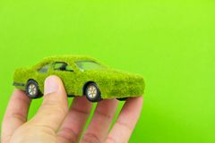 Eco car icon isolate on green backgro Stock Photos