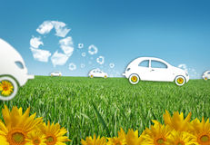 Eco cars. Eco car in the grass, recycle concept with sunflowers Royalty Free Stock Photography