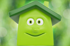 Eco cartoon house Stock Images