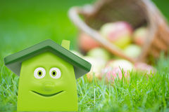 Eco green house against apples Royalty Free Stock Image
