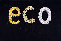 Eco cereals. Word ECO composed of groats on black background Royalty Free Stock Photos