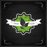 Eco chalk lettering label of organic natural fresh food. On blackboard Royalty Free Stock Photo