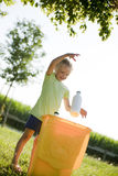 Eco children. Little girl recycling, throwing plastic bottle into recycling bin Royalty Free Stock Image