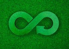 Green grass meadow transparent arrow infinity recycling symbol, 3D illustration. ECO and circular economy concept. Transparent arrow infinity recycling symbol on royalty free illustration