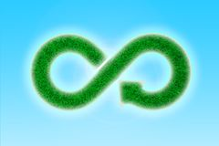 ECO, circular economy, green grass infinity arrow symbol. 3D illustration. Green Eco-friendly and circular economy concept. Infinity arrow recycling symbol with royalty free stock photography