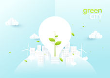 Eco city concept. Light bulbs with sapling in green ecology city Royalty Free Stock Images