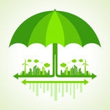 Eco city concept with umbrella Stock Photo