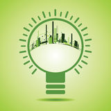 Eco City inside of  a green light bulb Stock Photography
