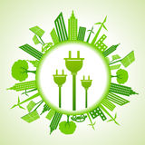 Eco cityscape with electric plug. Stock Royalty Free Stock Photos